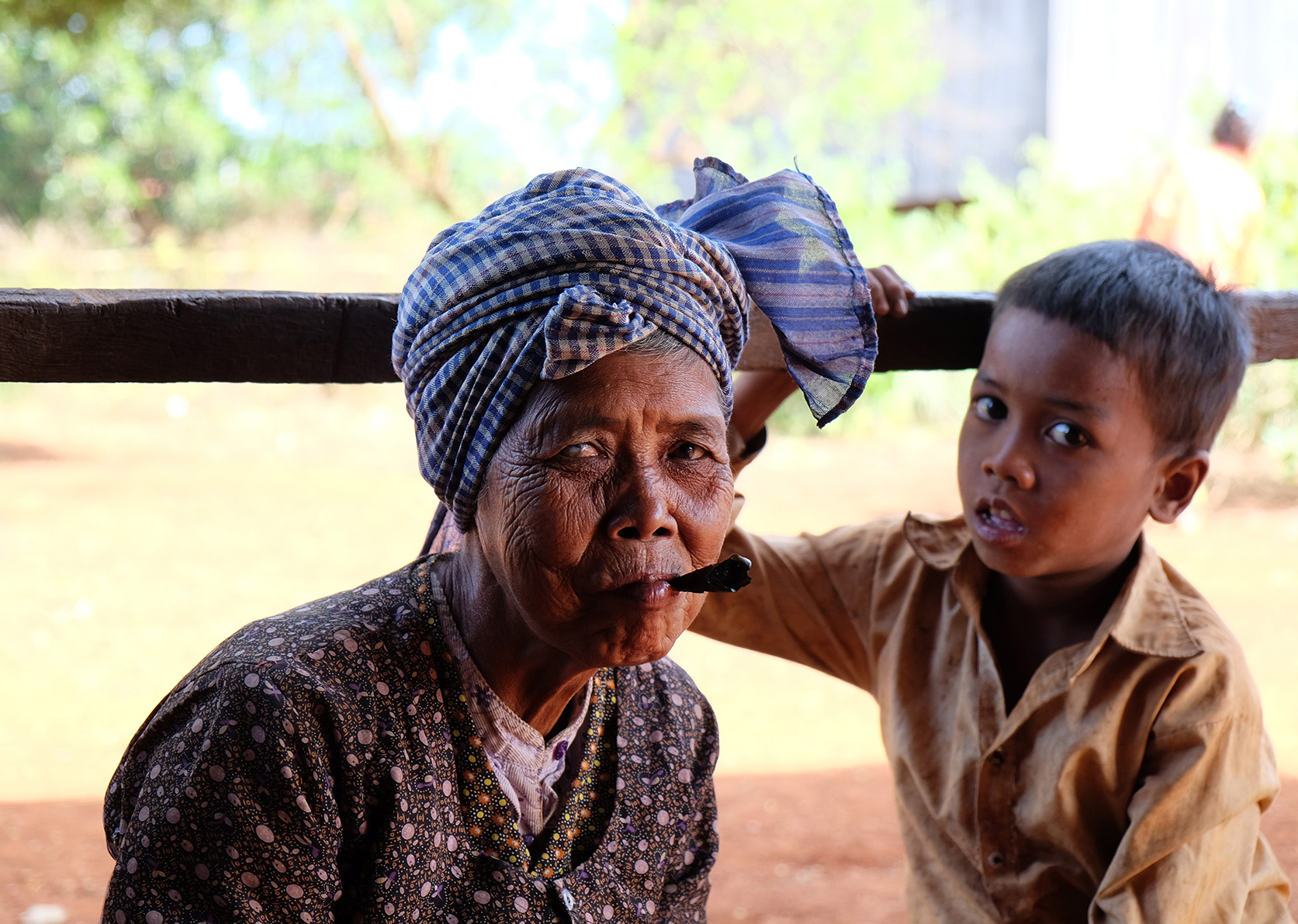 Old lady, smooking home made cigar in Cambodia